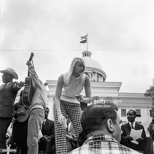 American singer and Civil Rights activist Mary Travers stands on a podium in front of the Alabama State Capitol at the end of the Selma to Montgomery...