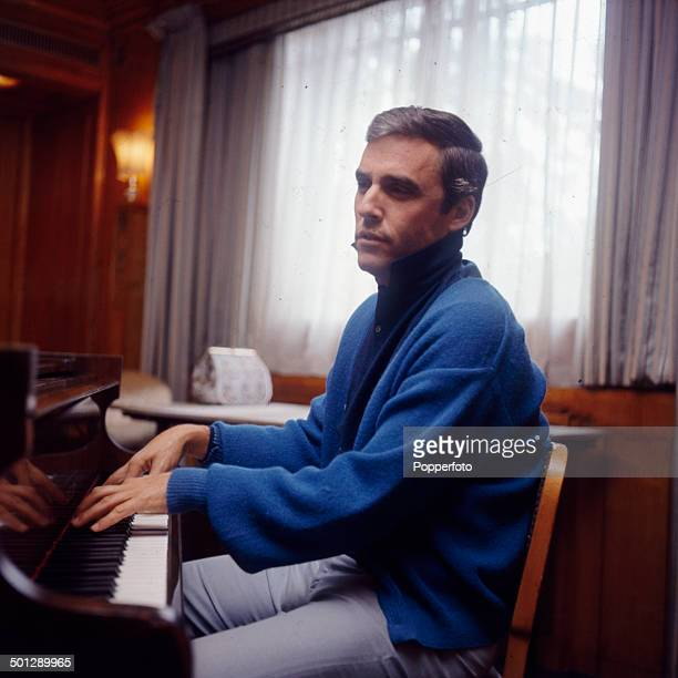 American singer and composer Burt Bacharach plays a piano in London in 1966