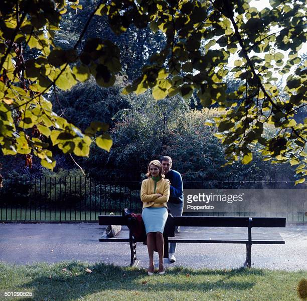American singer and composer Burt Bacharach posed with his wife actress Angie Dickinson in a London park in 1966