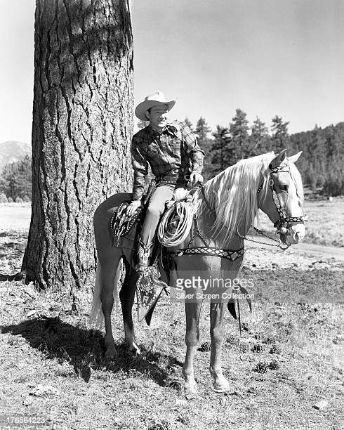 American singer and cowboy actor Roy Rogers on his horse Trigger circa 1945