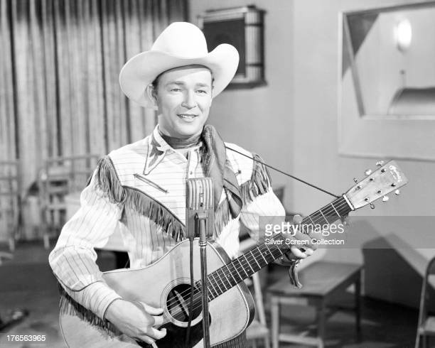 American singer and cowboy actor Roy Rogers playing an acoustic guitar circa 1940