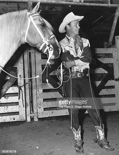 27145a4f777 American singer and cowboy actor Roy Rogers poses with palomino horse and  animal actor Trigger Philadelphia