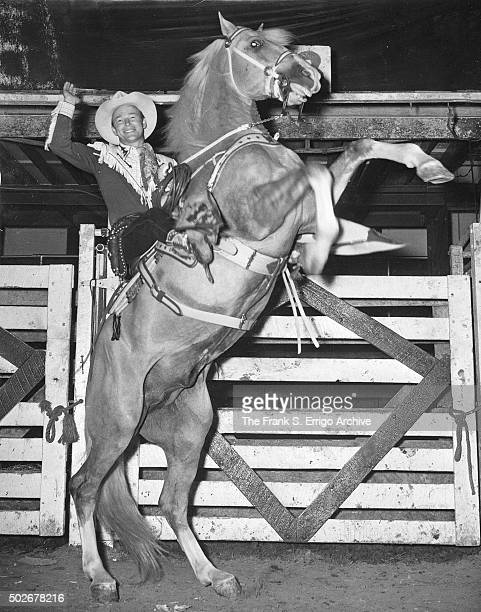 American singer and cowboy actor Roy Rogers rides palomino horse and animal actor Trigger Philadelphia Pennsylvania 1951