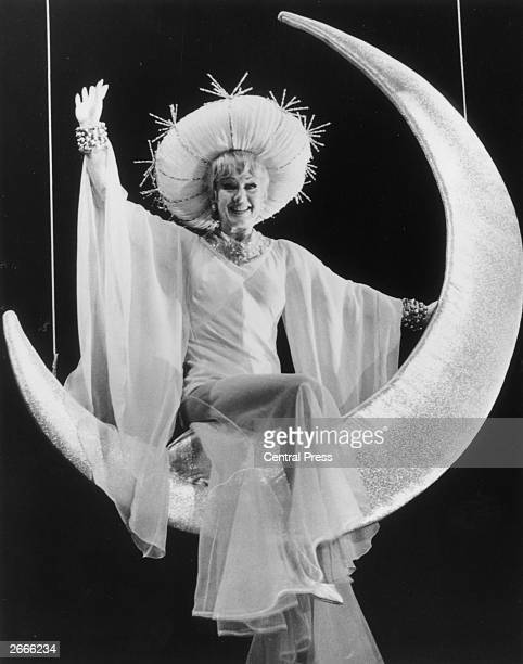 American singer and dancer Ginger Rogers wearing the 'Moon Lady' costume from the hit Broadway musical 'Mame' which is about to open at the Theatre...