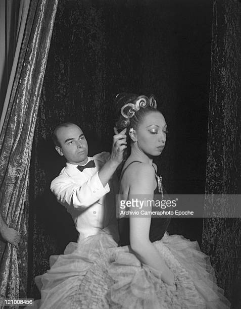 American singer and dancer Josephine Baker wearing a ballet dress portrayed before a performance while Jean Clement adjusting her hair Venice 1949