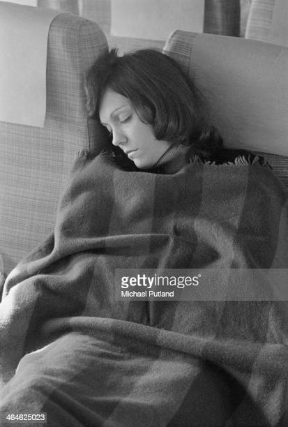 American singer and drummer Karen Carpenter of pop duo The Carpenters sleeping on an aircraft during a European tour Frankfurt West Germany 16th...