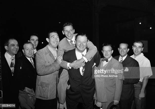 American singer and entertainer Frank Sinatra climbs onto the back of American restauranteur Bernard Toots Shor September 27 1944 The pair are...
