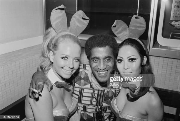 American singer and entertainer Sammy Davis Jr with Playboy Bunnies Patricia and May 12th August 1968