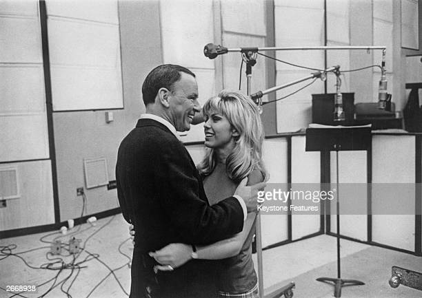 American singer and film actor Frank Sinatra with his daughter Nancy Sinatra at their first joint recording session