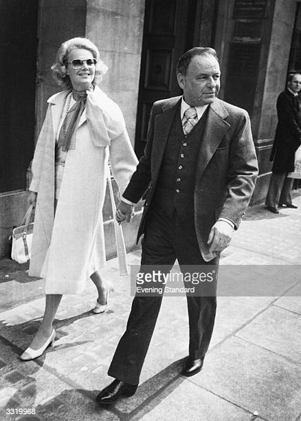 American singer and film actor Frank Sinatra with wife Barbara Marx in London