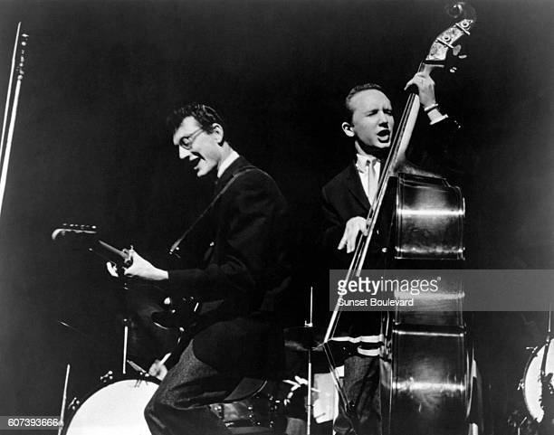 American singer and guitarist Buddy Holly and bassist Joe B.Mauldin perform during the Alan Freed Show in New York.