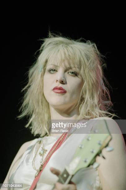 American singer and guitarist Courtney Love performs live on stage with the rock group Hole at Brixton Academy in London on 4th May 1995.