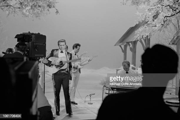 American singer and musician Buck Owens and his band the Buckaroos perform on the set of 'The Jimmy Dean Show', USA, 13th November 1964.