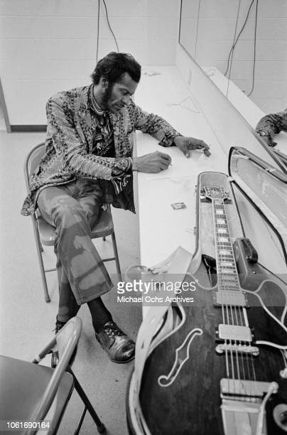 American singer and musician Chuck Berry backstage at Madison Square Garden in New York City during the making of the concert film 'Let the Good...