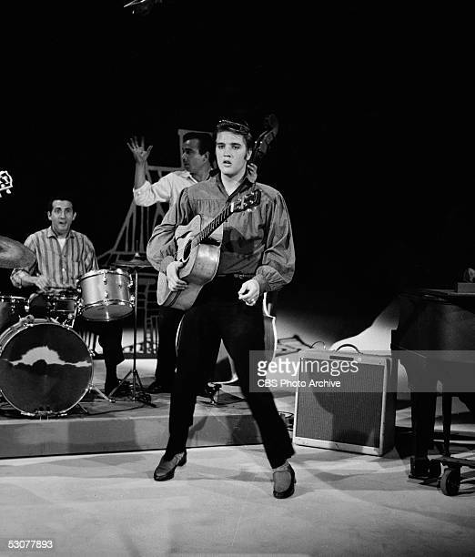 American singer and musician Elvis Presley on stage with his band on 'The Ed Sullivan Show,' Los Angeles, California, September 9, 1956.