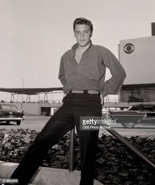 American singer and musician Elvis Presley poses outside CBS Television City Los Angeles California 1956 The was the year of Presley's landmark...