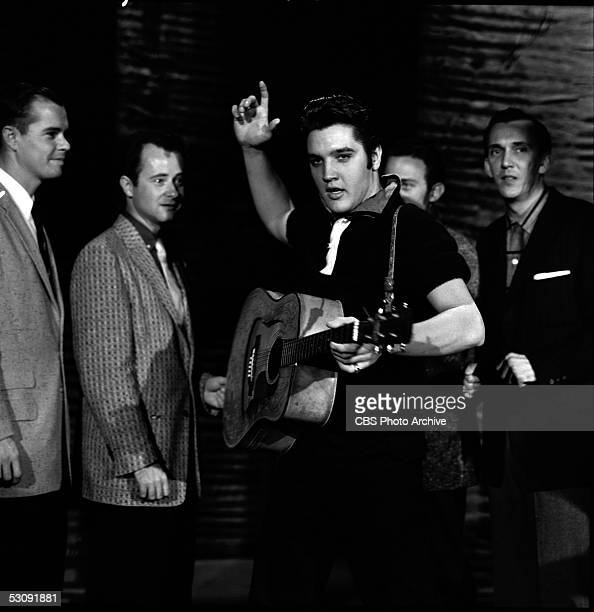 American singer and musician Elvis Presley rehearses with his group backstage before his second appearance on 'The Ed Sullivan Show,' New York, New...