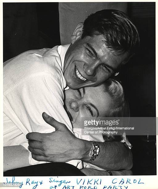 American singer and musician Johnnie Ray and singer Vikki Carol hug one an other at a birthday celebration for WNEW radio disk jocky Art Ford New...