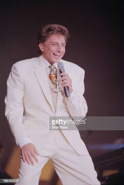American singer and songwriter Barry Manilow performs live on stage at Wembley Arena in London on 10th November 1994