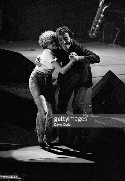 American singer and songwriter Bruce Springsteen dances with a member of his audience during a Wembley Arena concert London 29th May 1981