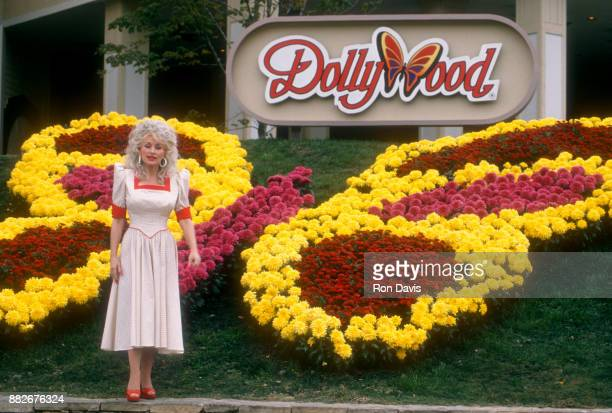 American singer and songwriter Dolly Parton poses for a portrait at Dollywood on October 24 1988 in Pigeon Forge Tennessee