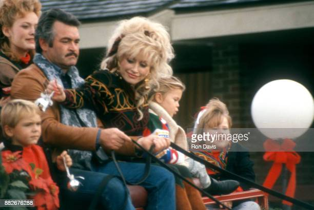 American singer and songwriter Dolly Parton rides on a carriage at Dollywood Theme Park circa 1993 in Pigeon Forge Tennessee