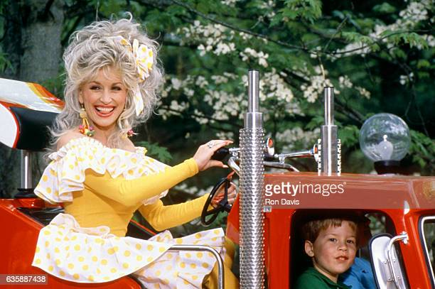 American singer and songwriter Dolly Parton rides on a truck at her Dollywood theme park circa 1997 in Pigeon Forge Tennessee