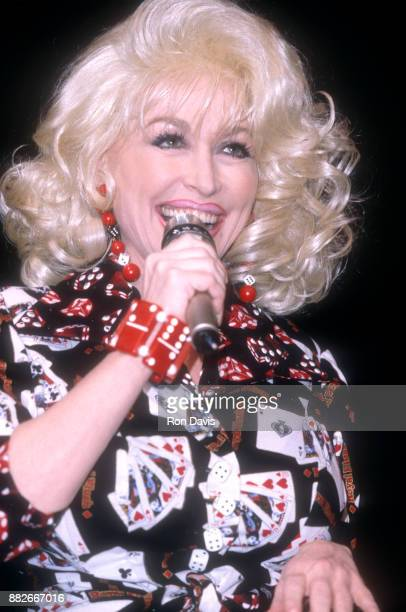 American singer and songwriter Dolly Parton sings during the 10th Anniversary of her Dollywood theme park circa April 1995 in Pigeon Forge Tennessee
