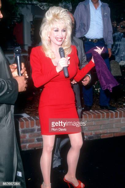 American singer and songwriter Dolly Parton speaks during the 10th Anniversary of her Dollywood theme park circa April 1995 in Pigeon Forge Tennessee