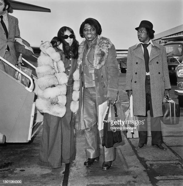 American singer and songwriter James Brown arrives at Heathrow Airport in London from Paris, accompanied by his wife Deidre or Dee Dee, née Jenkins,...
