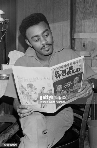 American singer and songwriter Johnnie Taylor reading 'RB World' backstage at the Apollo Theater in New York City 1968