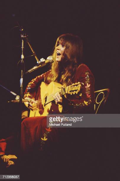 American singer and songwriter Melanie Safka performs live on stage playing an acoustic guitar in London on 24th June 1974