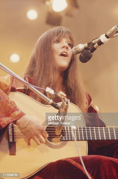 American singer and songwriter Melanie Safka performs live on stage playing an acoustic guitar at the Crystal Palace Bowl in London on 3rd June 1972