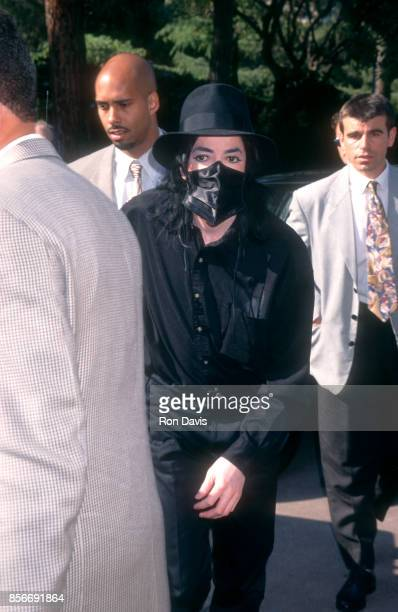 American singer and songwriter Michael Jackson wears a mask as he arrives for the 1996 World Music Awards on May 8 1996 at Salle des Etoiles in Monte...