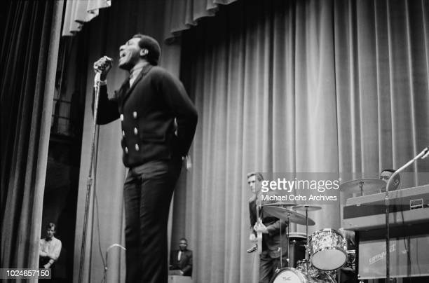 American singer and songwriter Otis Redding makes a surprise appearance at Hunter College New York City 21st January 1967 Behind him are guitarist...