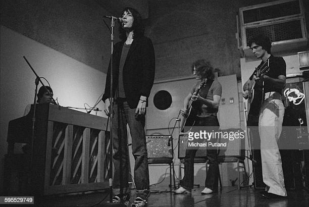 American singer and songwriter Patti Smith performing at the Ocean Club New York 21st July 1976 At far left is John Cale on keyboards and at far...