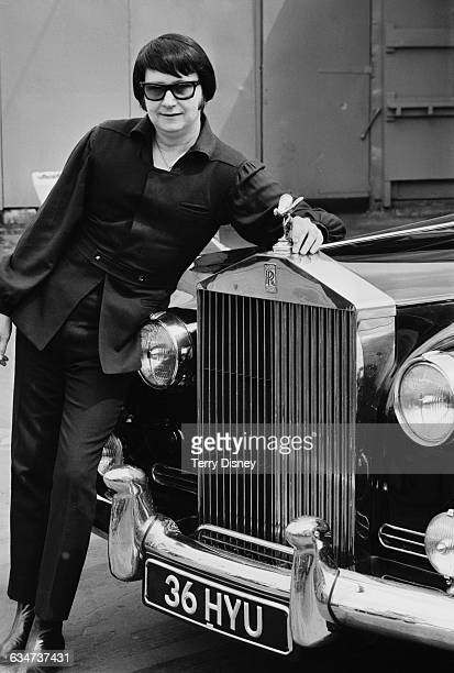 American singer and songwriter Roy Orbison leaning on a Rolls Royce at Festival Gardens in London, UK, 27th May 1970.