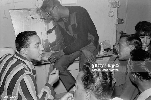 American singer and songwriter Smokey Robinson rehearses the song 'My Girl' with the Temptations in their dressing room at the Apollo Theater New...