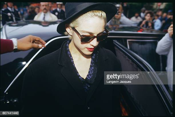 American singer and superstar Madonna gets out of her car as she arrives at the prestigious Parisian Hotel Crillon after landing at the Bourget...