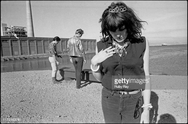 American singer artist and poet Exene Cervenka with members of punk group X at San Francisco Bay San Francisco US 8th September 1978