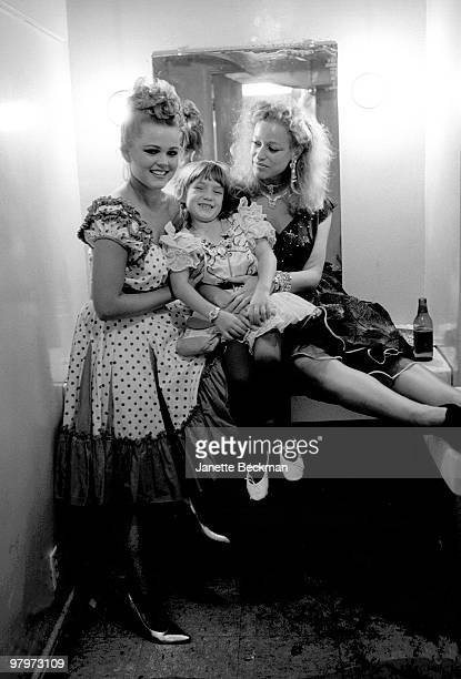 American singer Belinda Carlisle of the GoGo's poses with a woman identified as Rosemarie and an uinidentified child backstage before a performance...