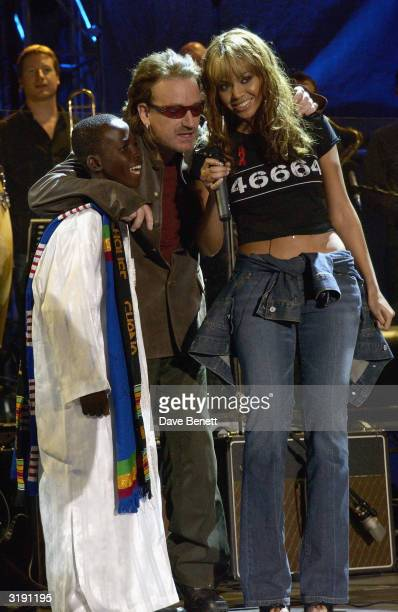 American singer Beyonce Knowles and British musician Bono perform on stage as part of the Give 1 Minute to AIDS concert for The Nelson Mandela...