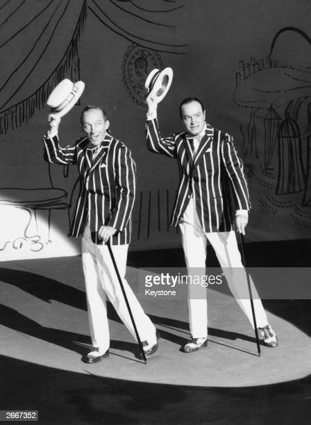 American singer Bing Crosby and comic actor Bob Hope on the film set of 'The Road to Hong Kong' at Shepperton Studios England