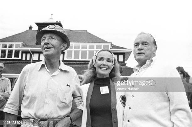 American singer Bing Crosby his wife Kathryn and comedian Bob Hope attend the ProAm golf tournament on August 06 1975 in Sunningdale England