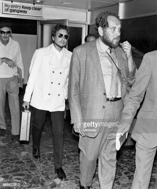 American singer Bob Dylan arrives at London's Heathrow Airport ahead of his performance at the Isle of Wight festival 25th August 1969