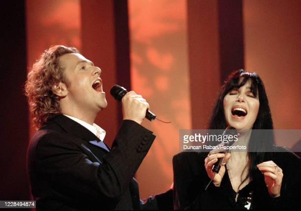 American singer Cher and British entertainer Michael Ball performing on the Michael Ball TV Show at in London, England on June 28, 1994.