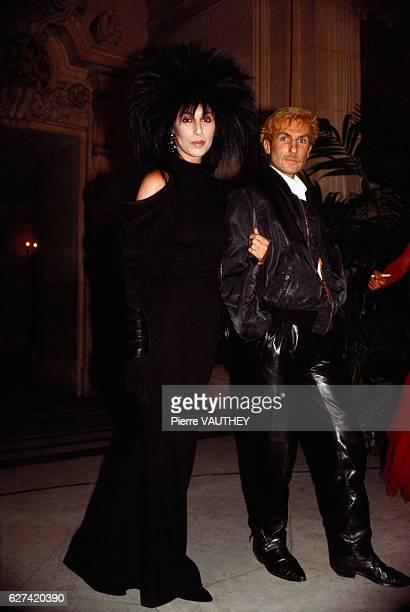 American singer Cher and French designer Claude Montana attend the 1985 Council of Fashion Designers of America Awards in New York