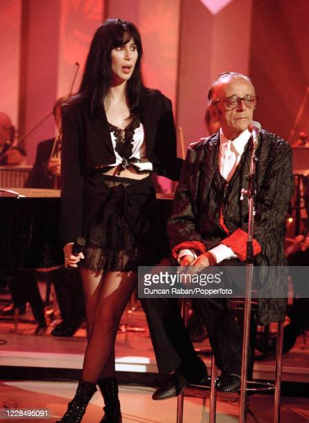 American singer Cher and harmonica player Larry Adler performing on the Michael Ball TV Show at in London, England on June 28, 1994.