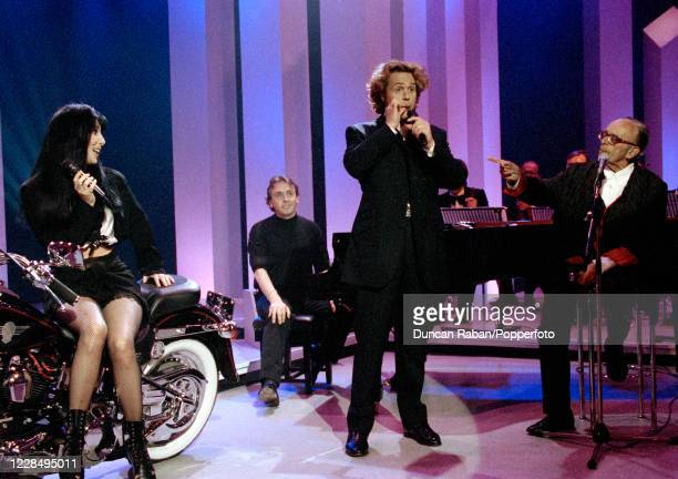 American singer Cher , harmonica player Larry Adler and British entertainer Michael Ball performing on the Michael Ball TV Show at in London, England...