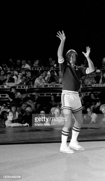 American singer, composer, actor, writer, television personality, motivational speaker, and spokesman Pat Boone shoots during warm-ups prior to the 3...